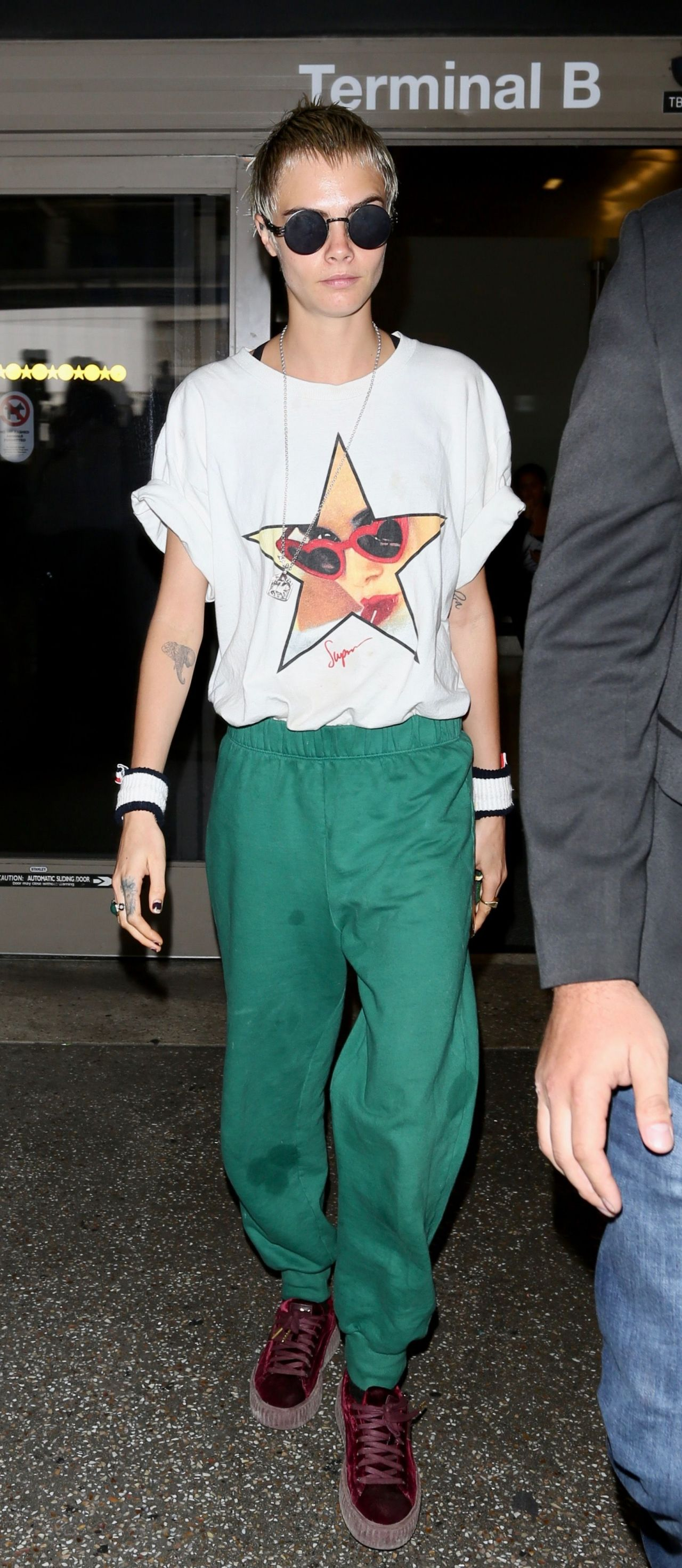 Cara Delevingne in Travel Outfit - LAX in Los Angeles 08/28/2017