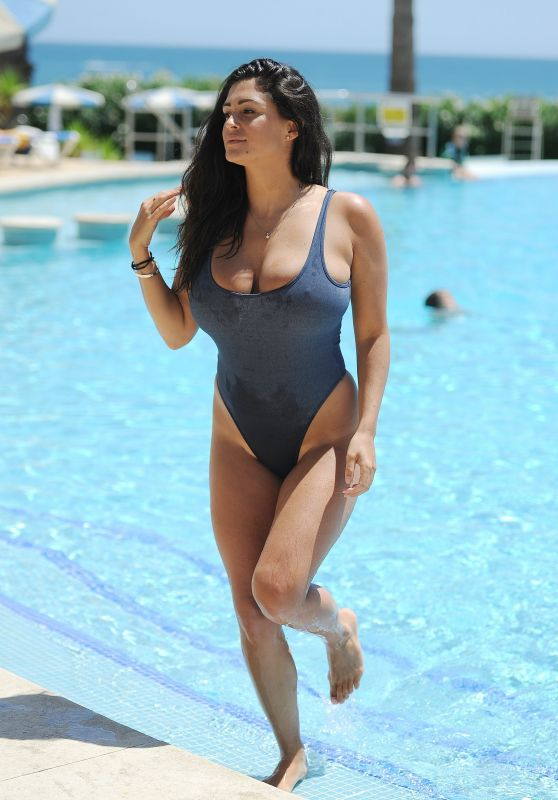 Casey Batchelor in a Blue Denim Swimsuit - Poolside in Portugal 08/15/2017