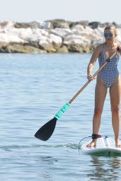 Tallia Storm in Swimsuit - Rides a Paddle Board in Marbella 08/18/2017