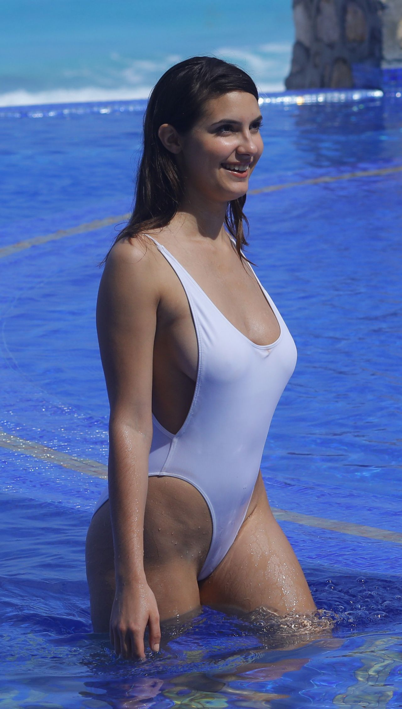 Tao Wickrath Shows Off Her Curves In White Swimsuit In