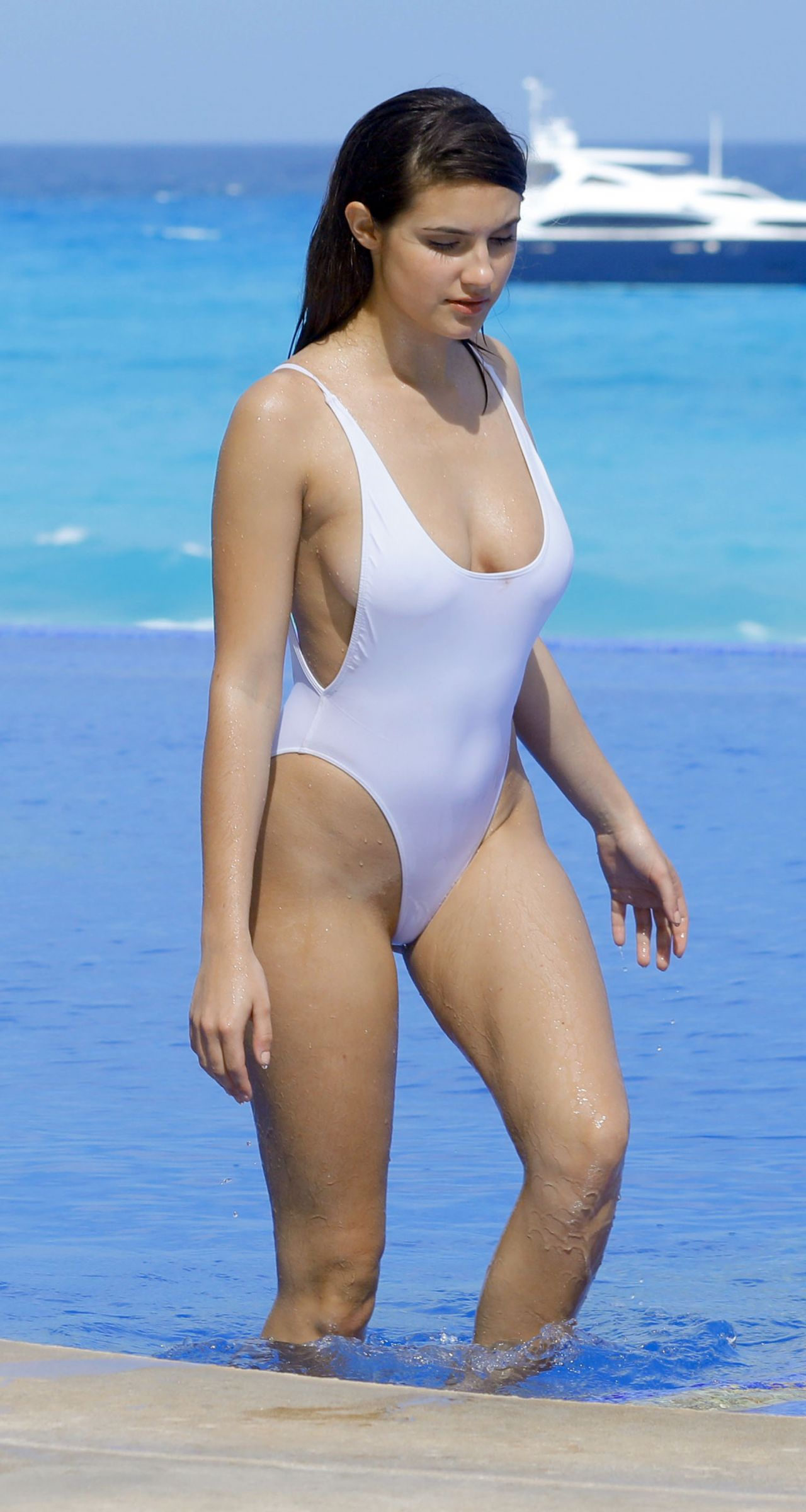 Tao wickrath shows off her curves in white swimsuit in for European pool show