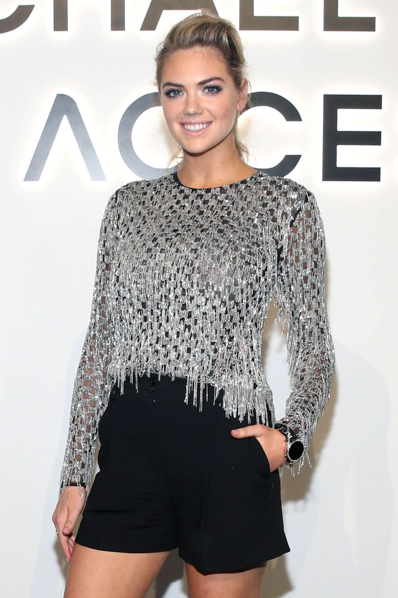 Kate Upton sexy and leggy at Michael Kors Access Party