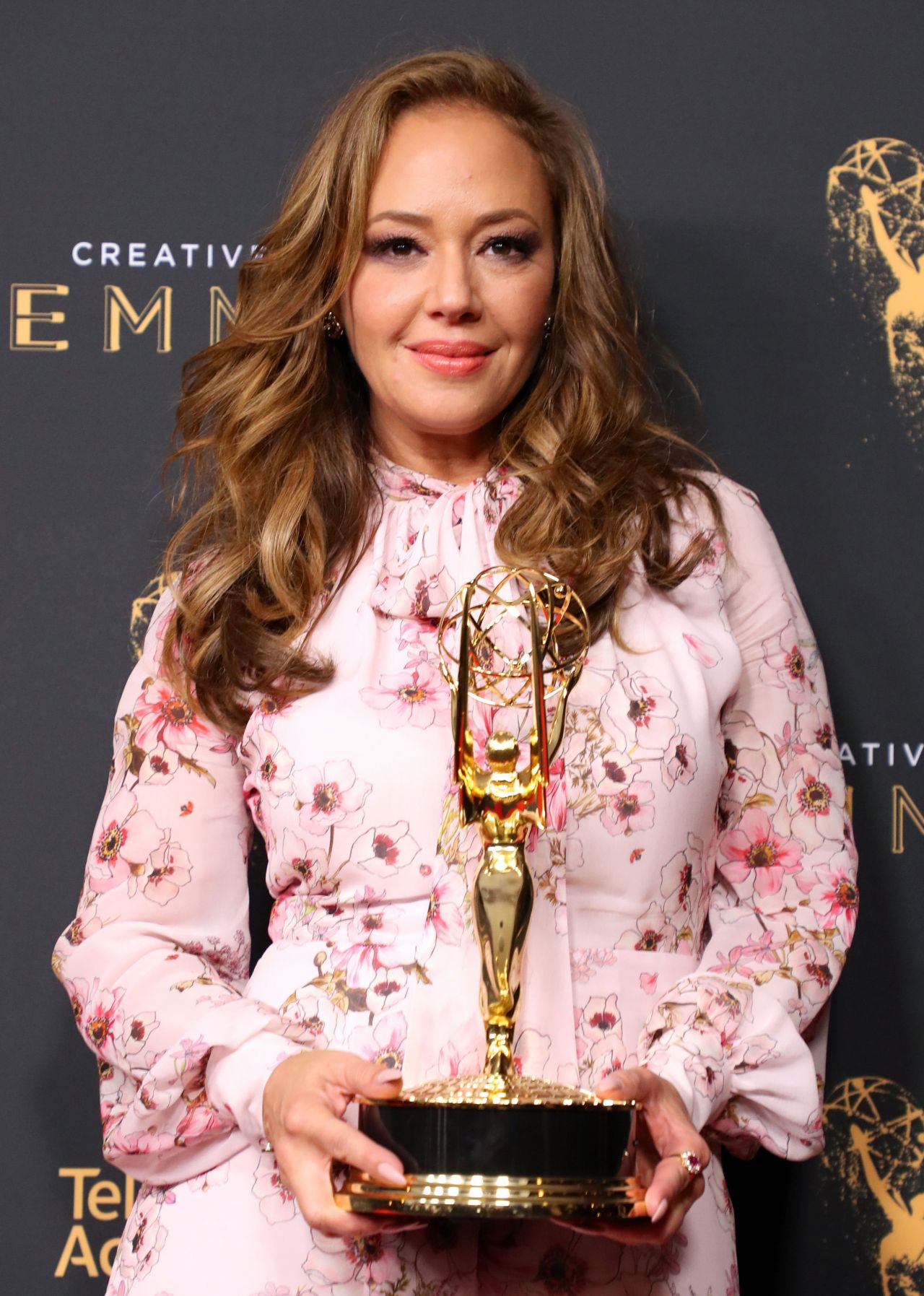 Leah Remini showing her Emmy Award