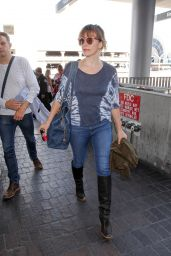 Milla Jovovich at LAX Airport in Los Angeles 09/18/2017