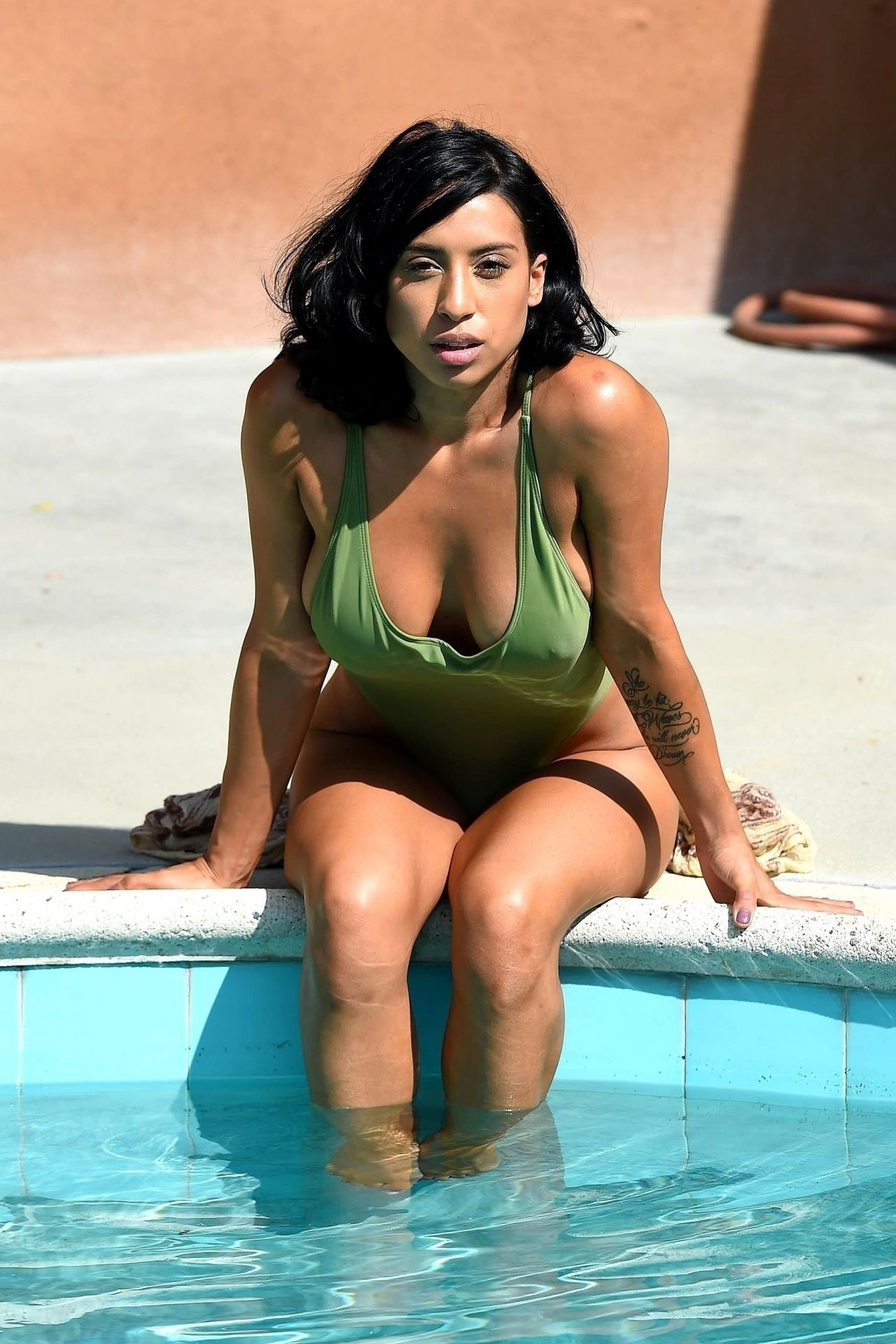 Montia Sabbag In A Green Swimsuit Pool Photoshoot At A