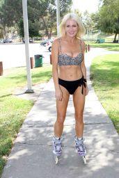 Sara Barrett in a Bikini Rollerblading in a Park in Glendora 09/22/2017
