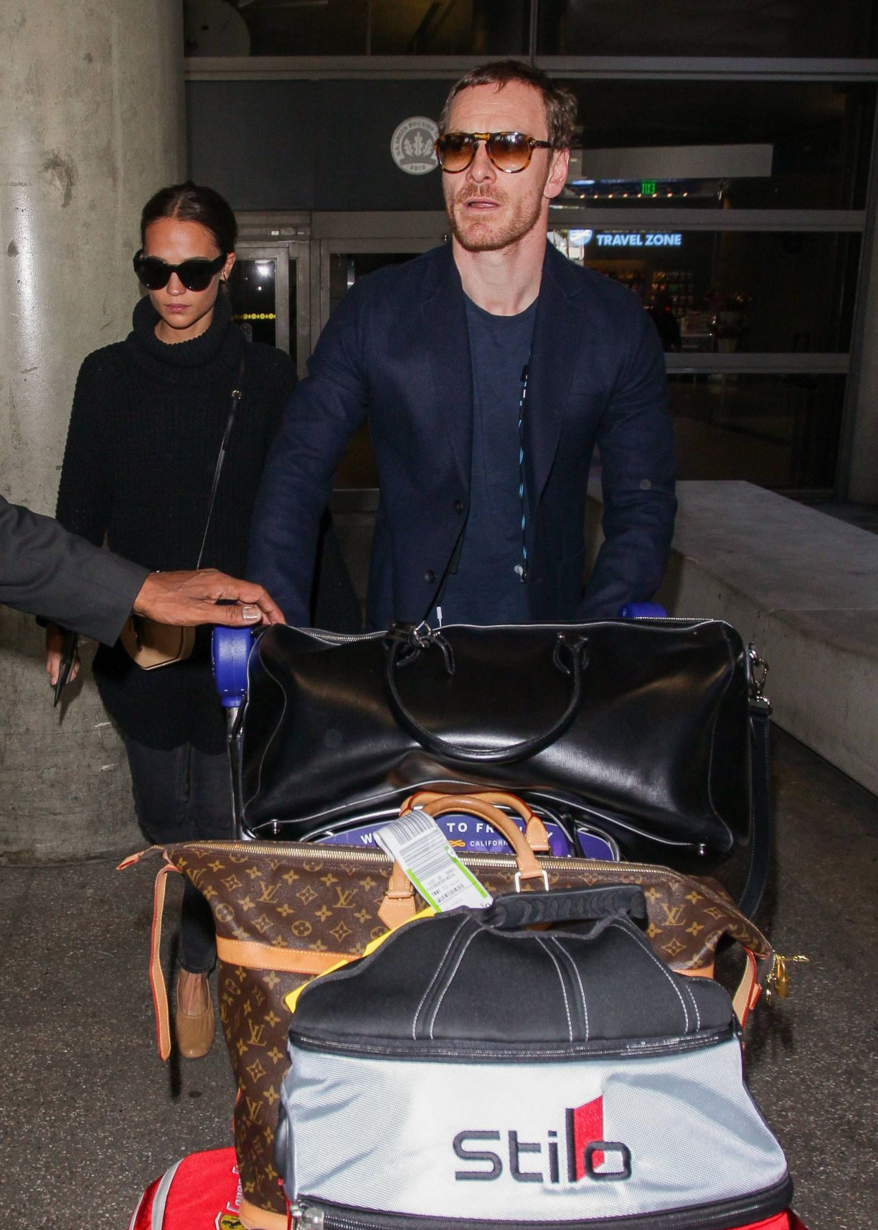Alicia Vikander and Michael Fassbender at LAX Airport in LA 10/04/2017