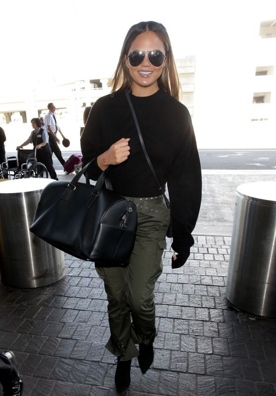 Chrissy Teigen in Travel Outfit - LAX in Los Angeles 10/02/2017