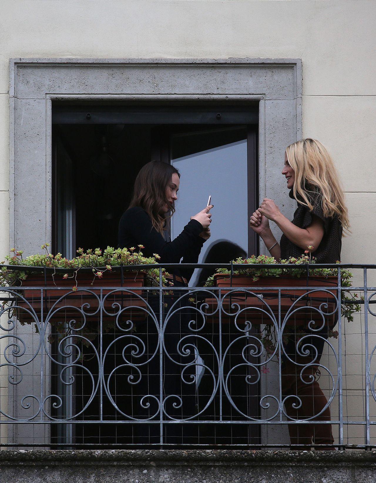 Michelle Hunziker - Poses on a Balcony in Milan 11/13/2017