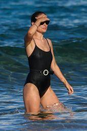 Olivia Wilde in a Black Swimsuit  - Paddle-Boarding in Hawaii 11/26/2017