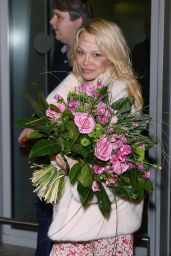 Pamela Anderson in Travel Outfit - Airport in Warsaw 11/24/2017