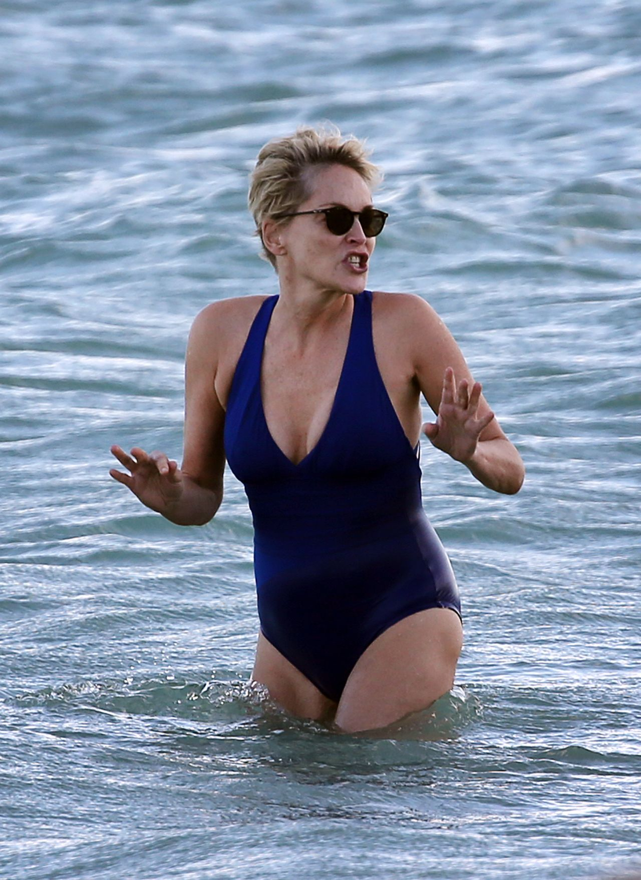 Sharon Stone in Bikini Top with her boyfriend at the beach in Miami Pic 21 of 35