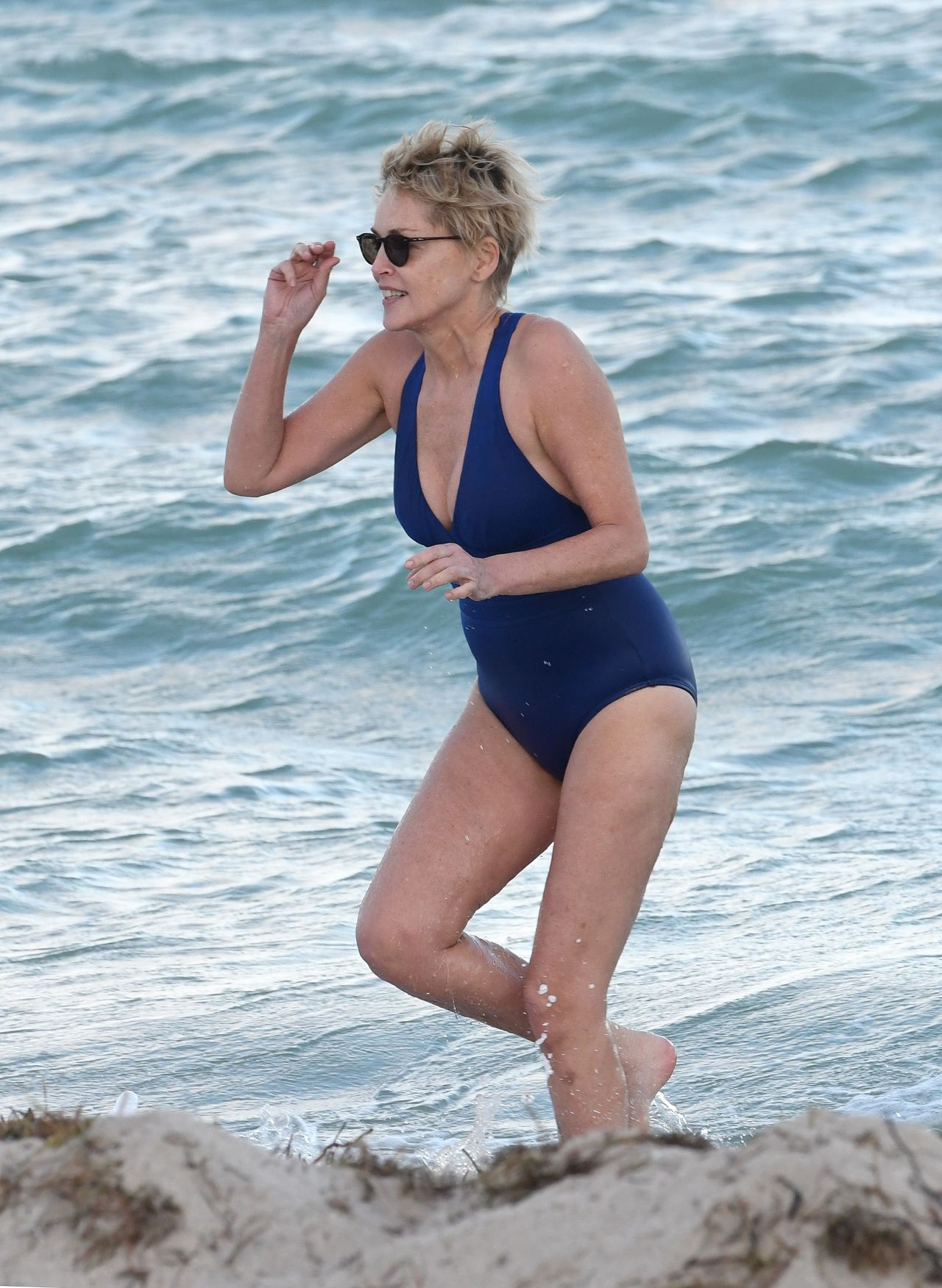 Sharon Stone in Bikini Top with her boyfriend at the beach in Miami Pic 27 of 35