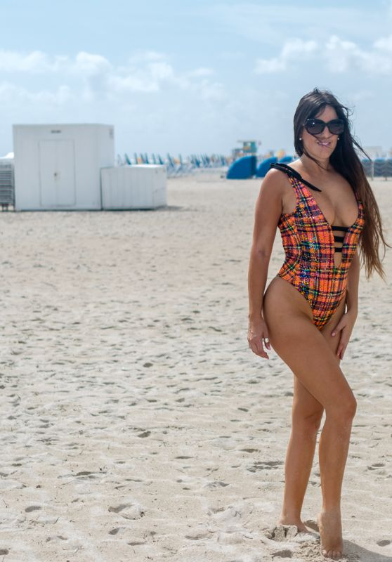 Claudia Romani in a Plaid Swimsuit on South Beach in Miami