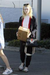 Elle Fanning Stop By a UPS Store to Pick Up a Package in Studio City