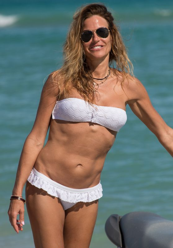Kelly Bensimon in a White Bikini on the Beach in Miami