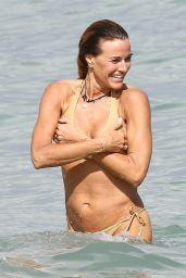 Kelly Bensimon in Two Different Bikinis on the Beach in Miami