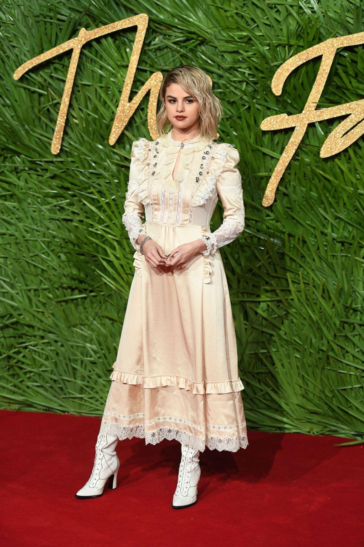 http://celebmafia.com/wp-content/uploads/2017/12/selena-gomez-fashion-awards-2017-in-london-0.jpg
