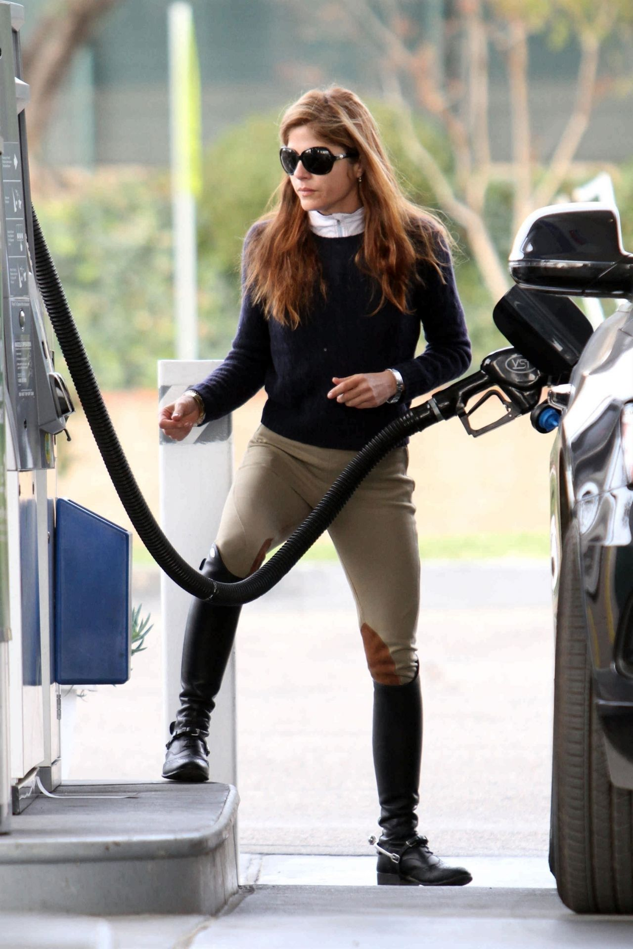 Selma Blair in Riding Outfit Pumping Gas in Los Angeles