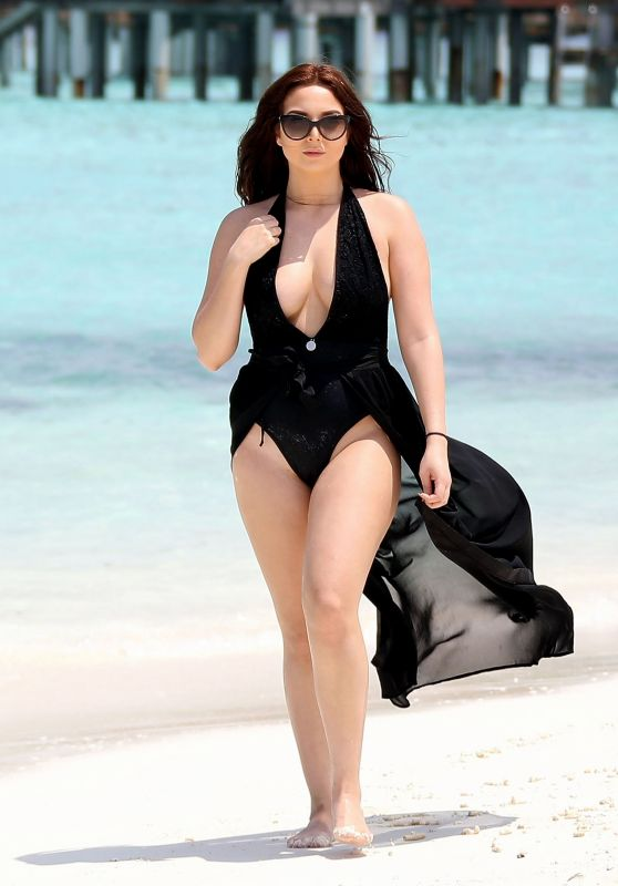 Amelia Goodman in a Black Swimsuit in the Bahamas