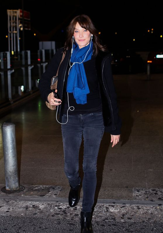 Carla Bruni in Travel Outfit at Madrid Airport