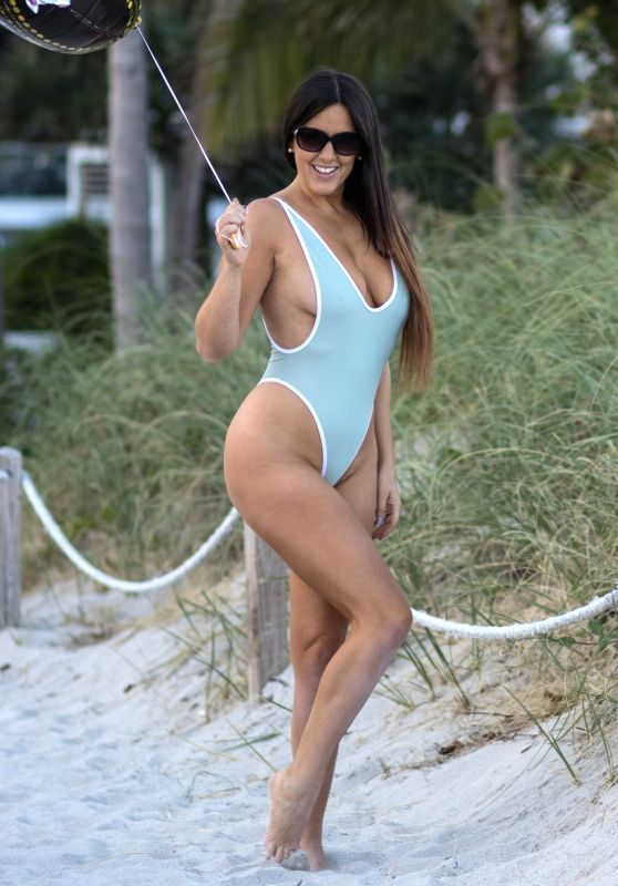 Claudia Romani in a Baby Blue Swimsuit on South Beach in Miami