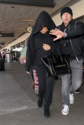 Demi Lovato Covering Up in a Large Hoodie at LAX Airport