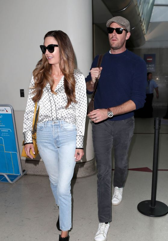 Elizabeth Chambers and Armie Hammer at LAX International Airport in Los Angeles