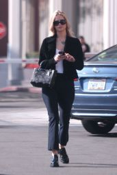 Jennifer Lawrence in Office Chic Outfitin Westwood