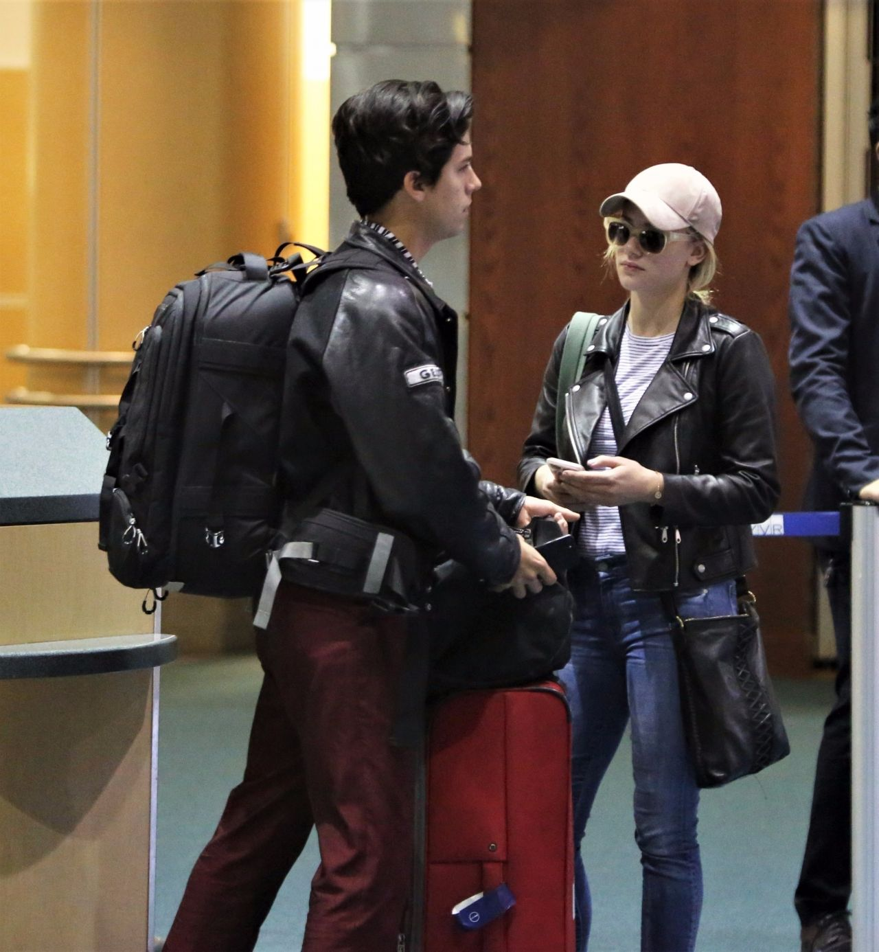 lili reinhart and cole sprouse arriving back in vancouver
