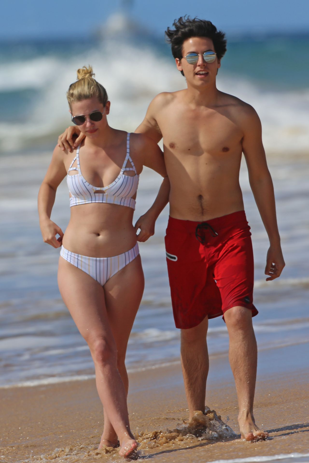 Lili Reinhart And Cole Sprouseon The Beach In Hawaii