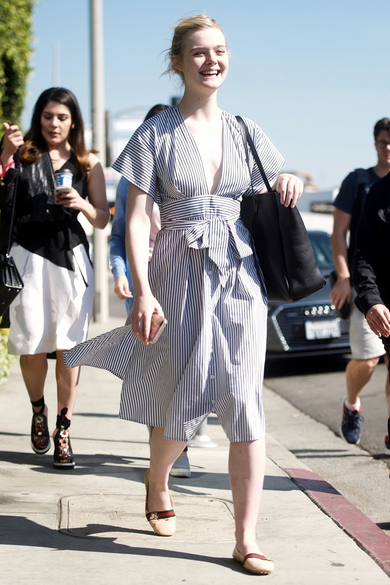 Elle fanning shopping on melrose place in west hollywood for Le elle apartments west hollywood