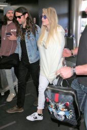 Kesha in a Gucci Hoodie and Brad Ashenfelter at LAX Airport