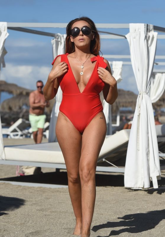 Laura Simpson in a Red Swimsuit on the Beach in the Canary Islands