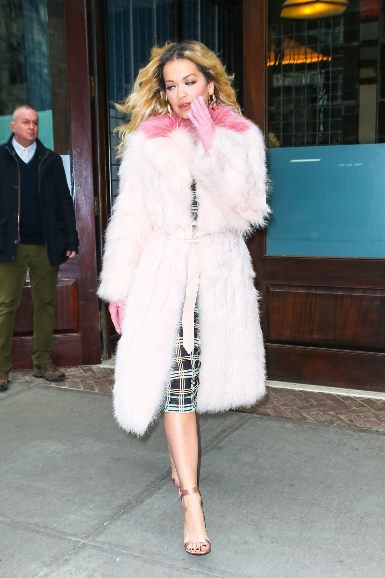 Rita Ora In A Pink Fur Coat With Pink Gloves Heads To The