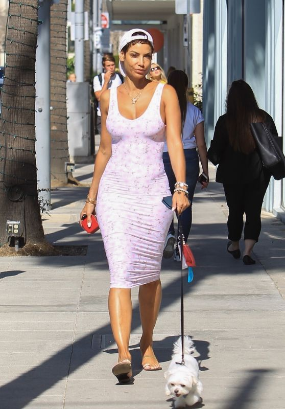 Nicole Murphy in a Form Fitting Pink Dress - Shopping in Beverly Hills 03/28/2018