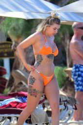 Olivia Buckland in a Orange Swimsuit in Barbados 03/13/2018
