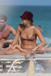 Annie McGinty in a Brown Bikini in the Ocean in Miami Beach 04/04/2018