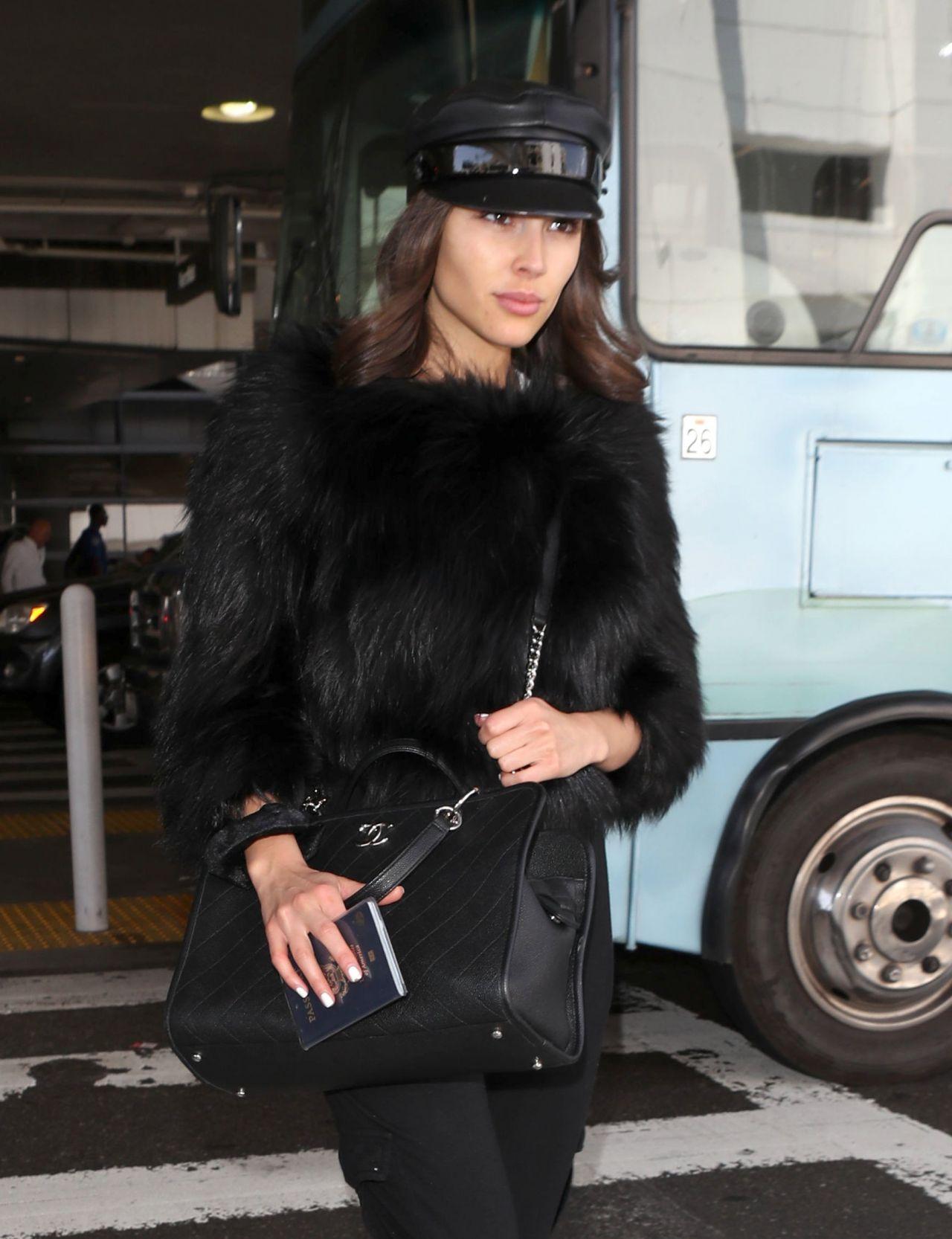 Olivia Culpo Wearing A Furry Black Crop Top And Black