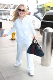 Dakota Fanning in Travel Outfit - LAX Airport in Los Angeles 05/24/2018