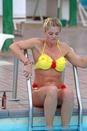 Danniella Westbrook in a Yellow Bikini by the Poolside in Spain 05/28/2018