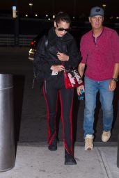 Bella Hadid in Fear Of God Pants with Off White Sunglasses and a Prada Handbag - JFK Airport in New York 06/14/2018