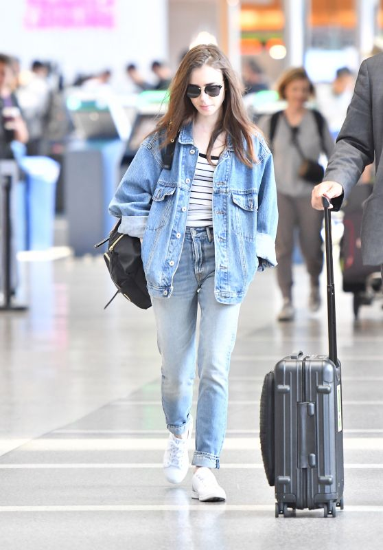 Lily Collins - LAX Airport in Los Angeles 06/04/2018