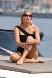Hofit Golan in a Black Asymmetrical Bikini on a Boat in Ischia