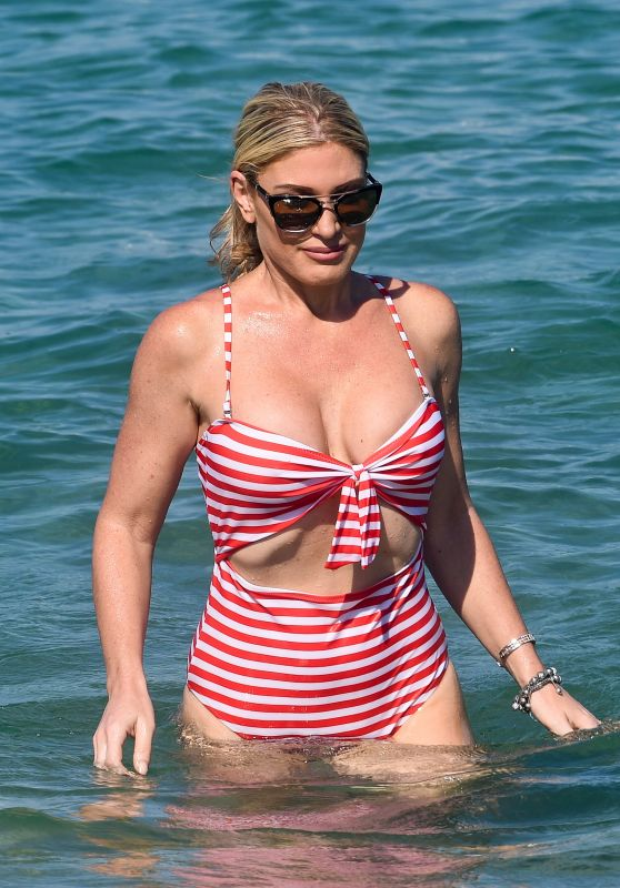 Hofit Golan in a Red & White Striped Swimsuit in Saint-Tropez