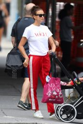 Irina Shayk in a Vogue T-Shirt and Bright Red Tracksuit Pants in NYC