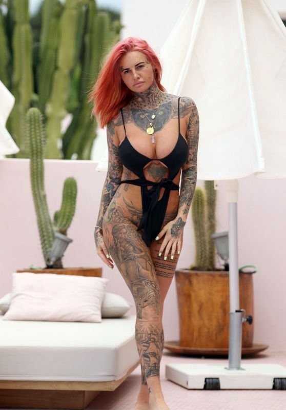 Jemma Lucy in Swimsuit Relaxing Poolside in Ibiza 07/23/2018