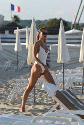Kimberley Garner in a White Swimsuit on the Beach in Saint-Tropez 07/22/2018