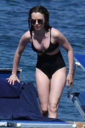 Lily Collins in a Black Swimsuit in Ischia Porto