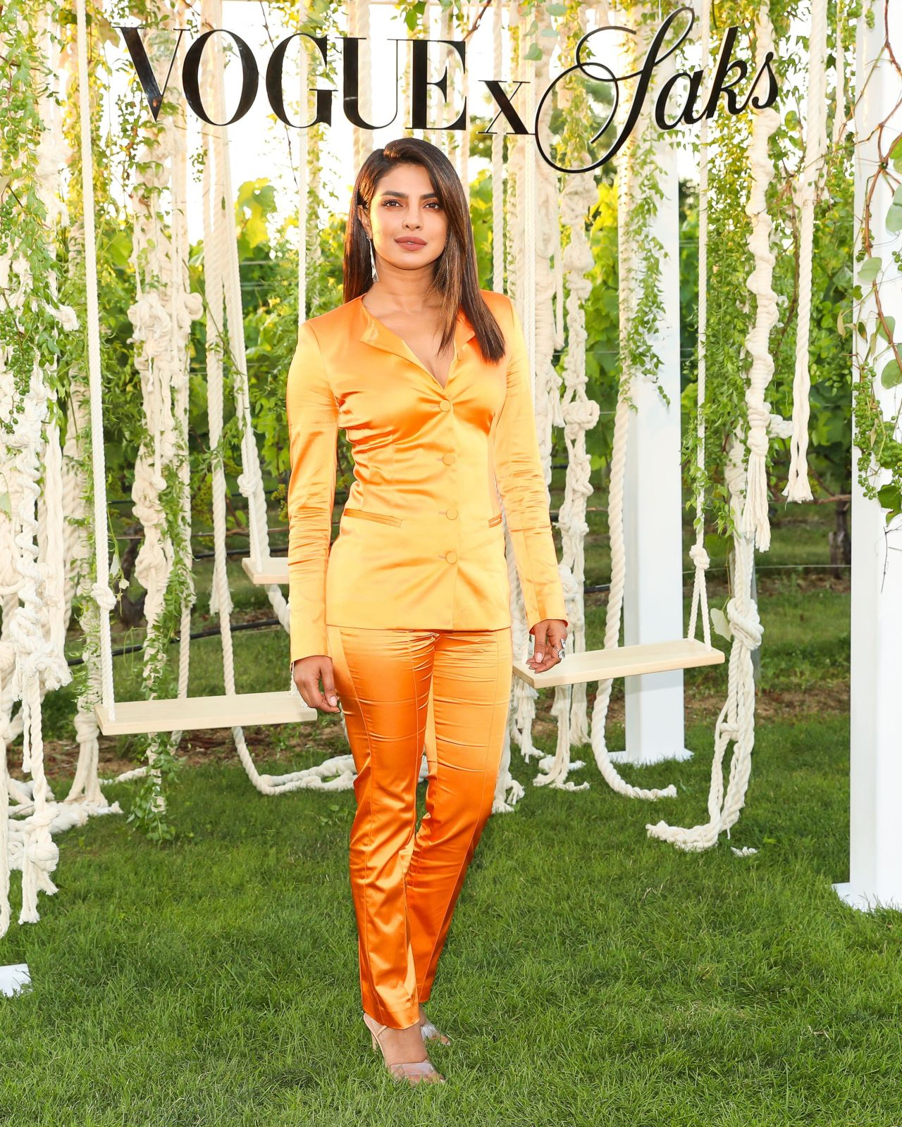 https://celebmafia.com/wp-content/uploads/2018/07/priyanka-chopra-saks-vogue-summer-celebration-07-12-2018-9.jpg
